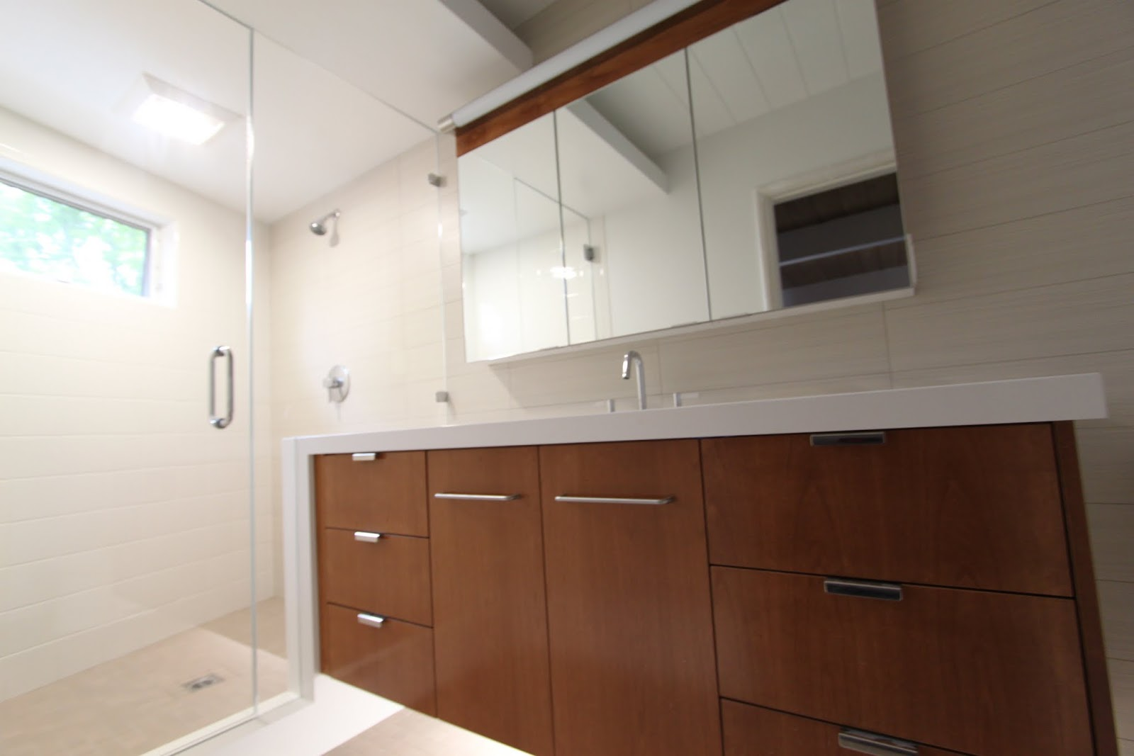 fabulous master shower and cabinet we have only one sink so we can have two banks of drawers storage is a premium in a mid century modern