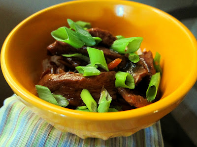 Mongolian Beef cooked in crock pot and served over rice with choped scallions
