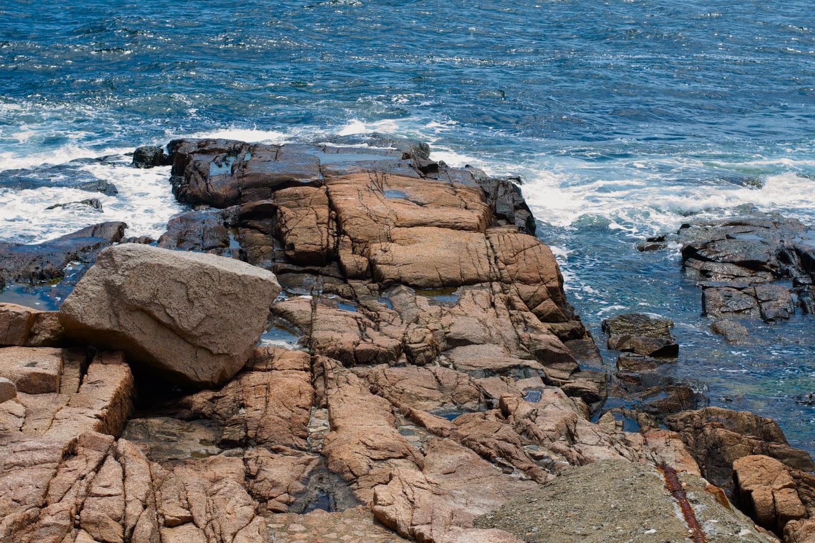 I enjoy watching the ocean breathe over the rocks along the coast.