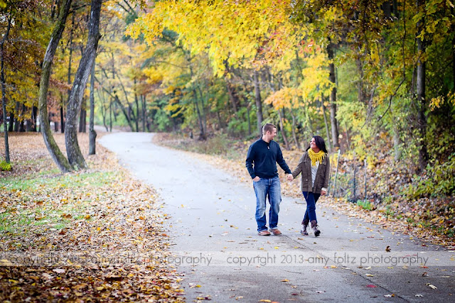 a couple walking through Fowler Park in Terre Haute in the fall - Terre Haute photographer