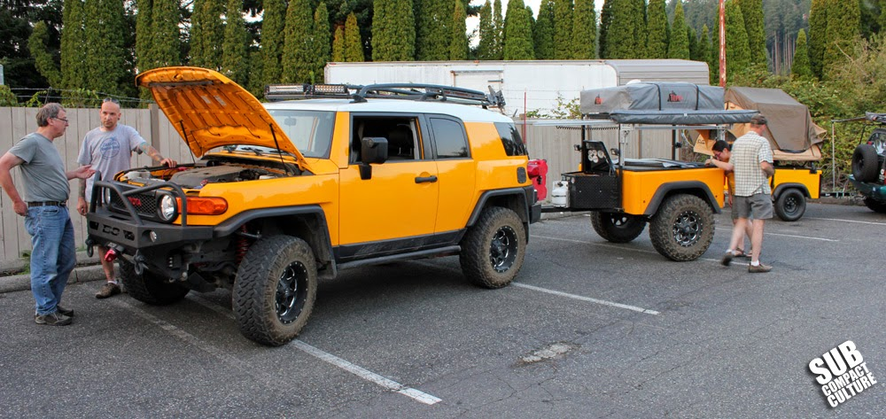 Lifted yellow Toyota FJ Cruiser with trailer
