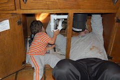 Brandon helping Uncle Jody put in the new faucet!