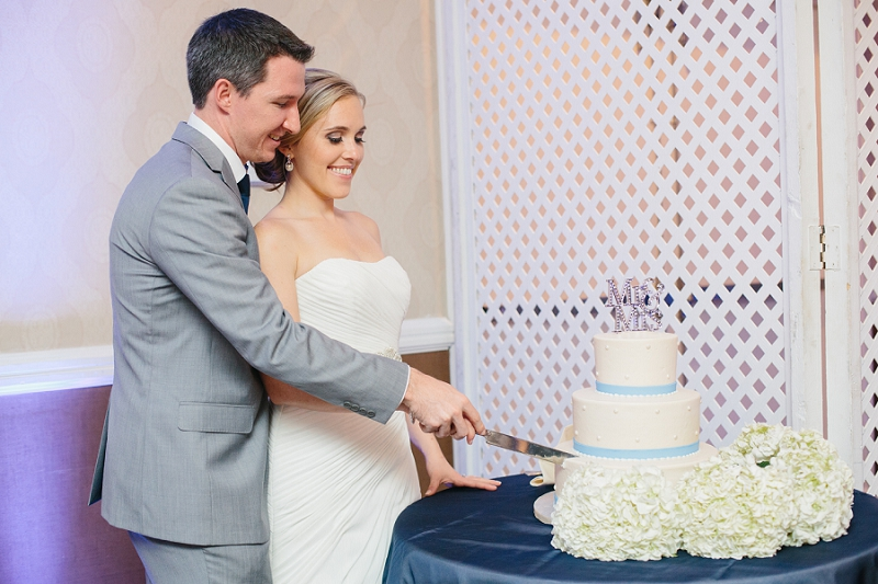 bride and groom cake cutting at wedding