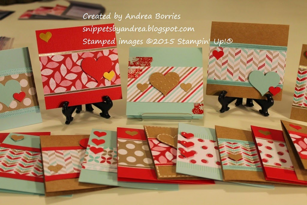 A variety of valentines made with strips of patterned paper and punched hearts.