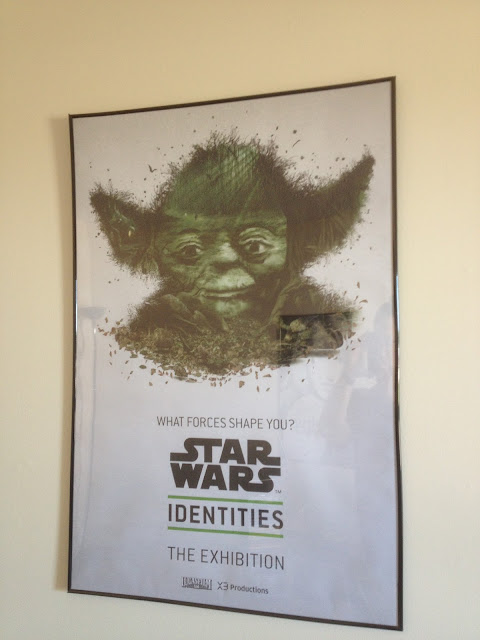 "A poster for Star Wars Identities.  Scenes from the swamps of Deigobah form Yoda's face, with the exhibit's slogan, ""What forces shape you?"""