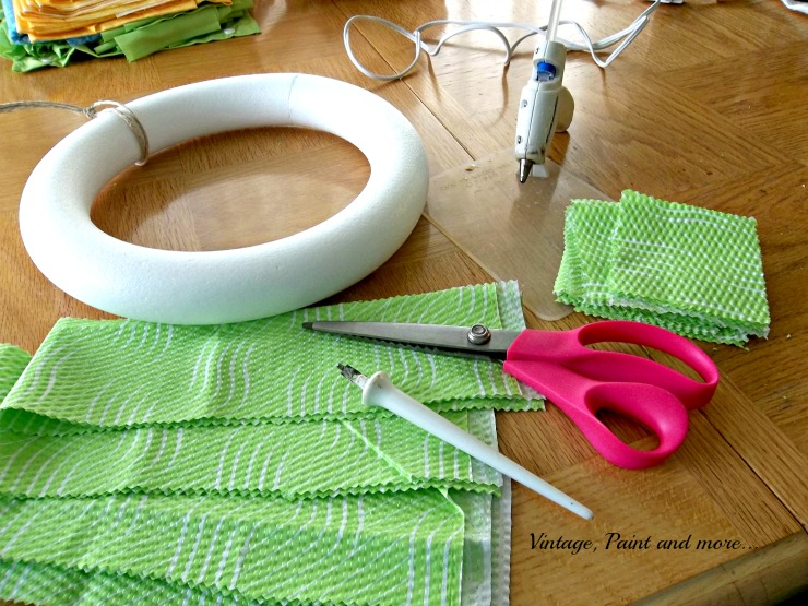 Vintage, Paint and more... Supplies used to make a spring wreath - Styrofoam wreath form, pinking shears, hot glue and fabric