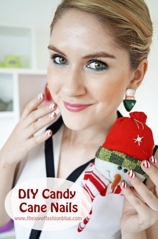 Cute candy cane nails for Christmas. Click through for full tutorial!