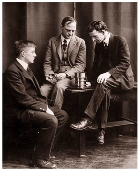 This photograph shows Whitney, Coolidge, and Langmuir in discussions at the General Electric research laboratories in Schenectady.