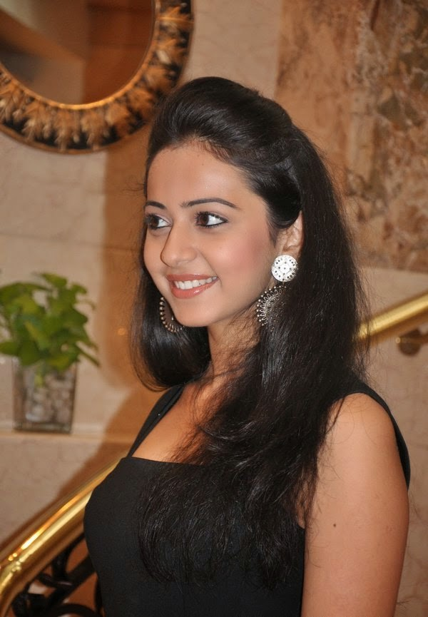 Rakul Preet Singh Looks very hot and sexy in her tight black mini skirt hot upskirt pics hd