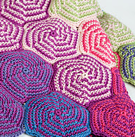 http://www.ravelry.com/patterns/library/pinwheel-blanket-3