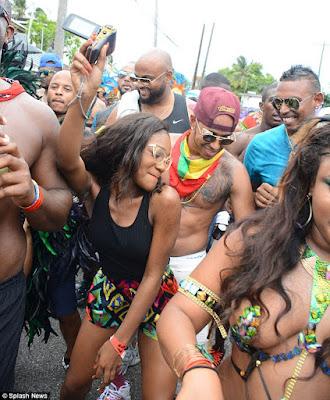 Rihanna & Lewis Hamilton cosy up at Barbados festival  2B16A96F00000578-3184374-image-a-120_1438694857816