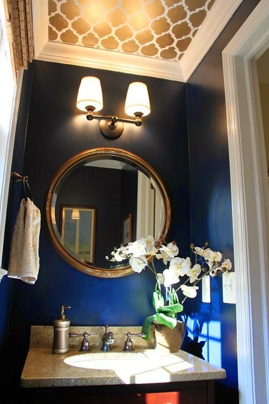 navy blue powder room gold mirror and lighting