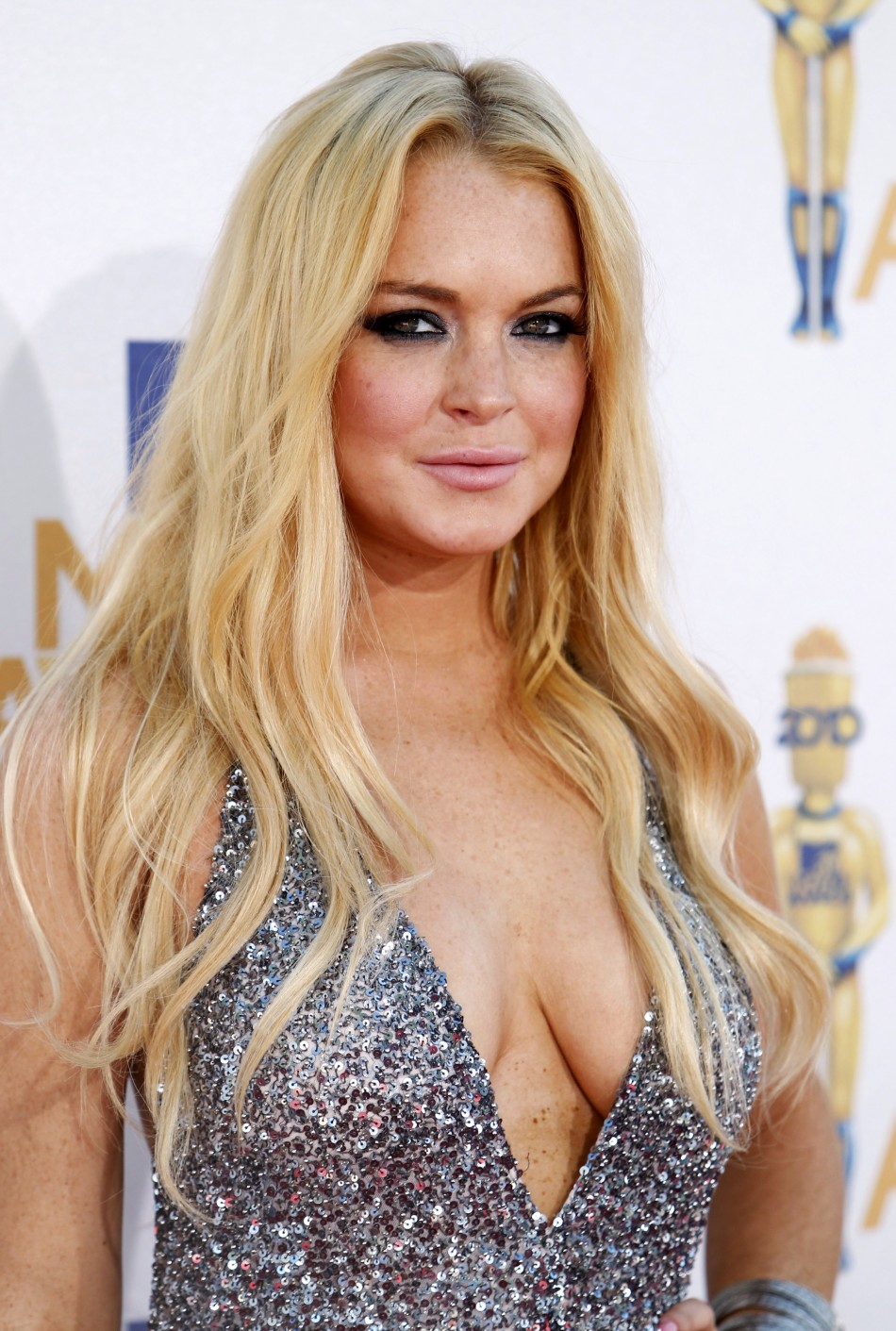 179142 actress lohan arrives at the 2010 mtv movie awards in los angeles That's right, Russian Bear Gay King Putin Won The President Election !
