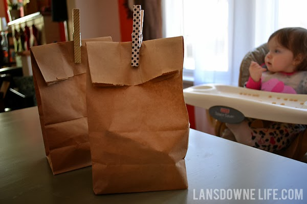 Brown paper lunch bags with clothespins
