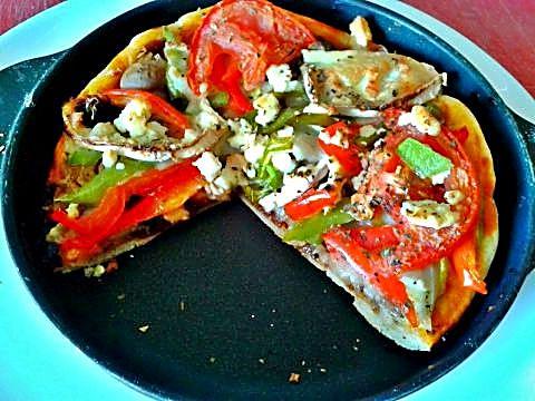 Corte pizza con cebolla caramelizada y mas