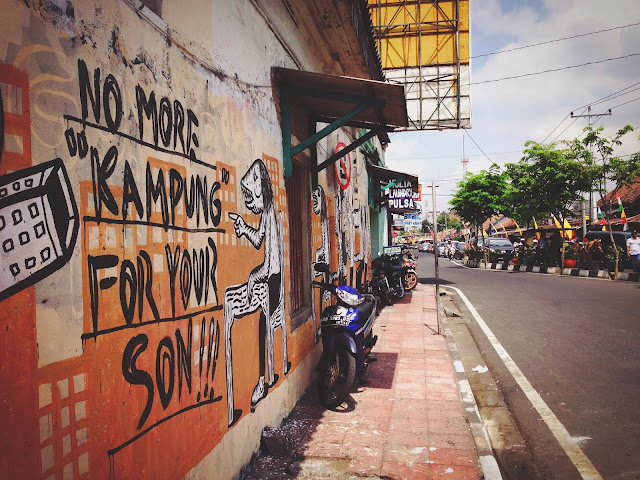 Street Art of Yogyakarta along Jalan Malioboro- No more kampung for your son!