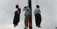 Iran: Three hanged in public