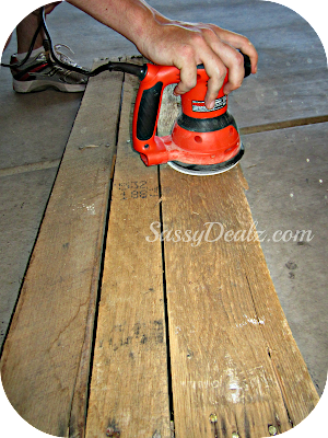sanding the wood pallet for the wine rack