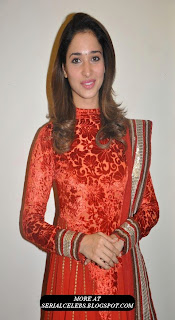 Tamanna Latest stills in red dress