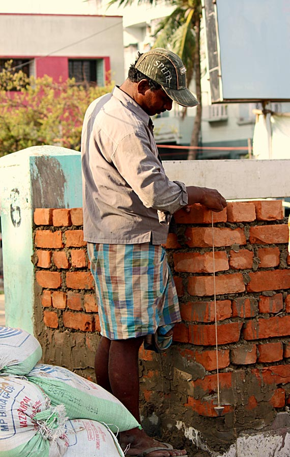 mason at work laying bricks