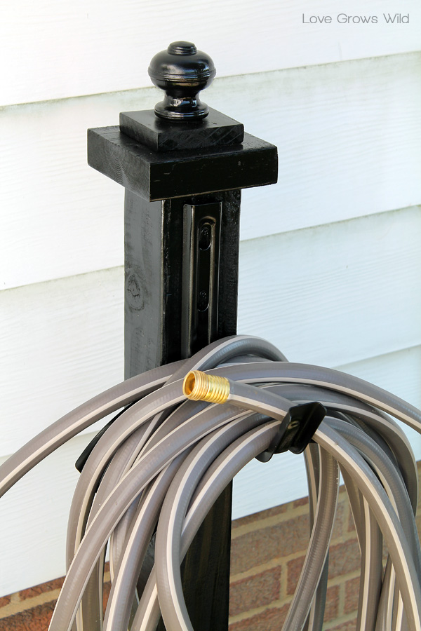 LoveGrowsWild.com | Make This DIY Garden Hose Holder To Add Great Curb  Appeal To