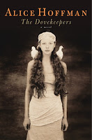 Book cover of The Dovekeepers, featuring a young Jewish girl wrapped in a white dress and headdress with two doves sitting on her shoulders