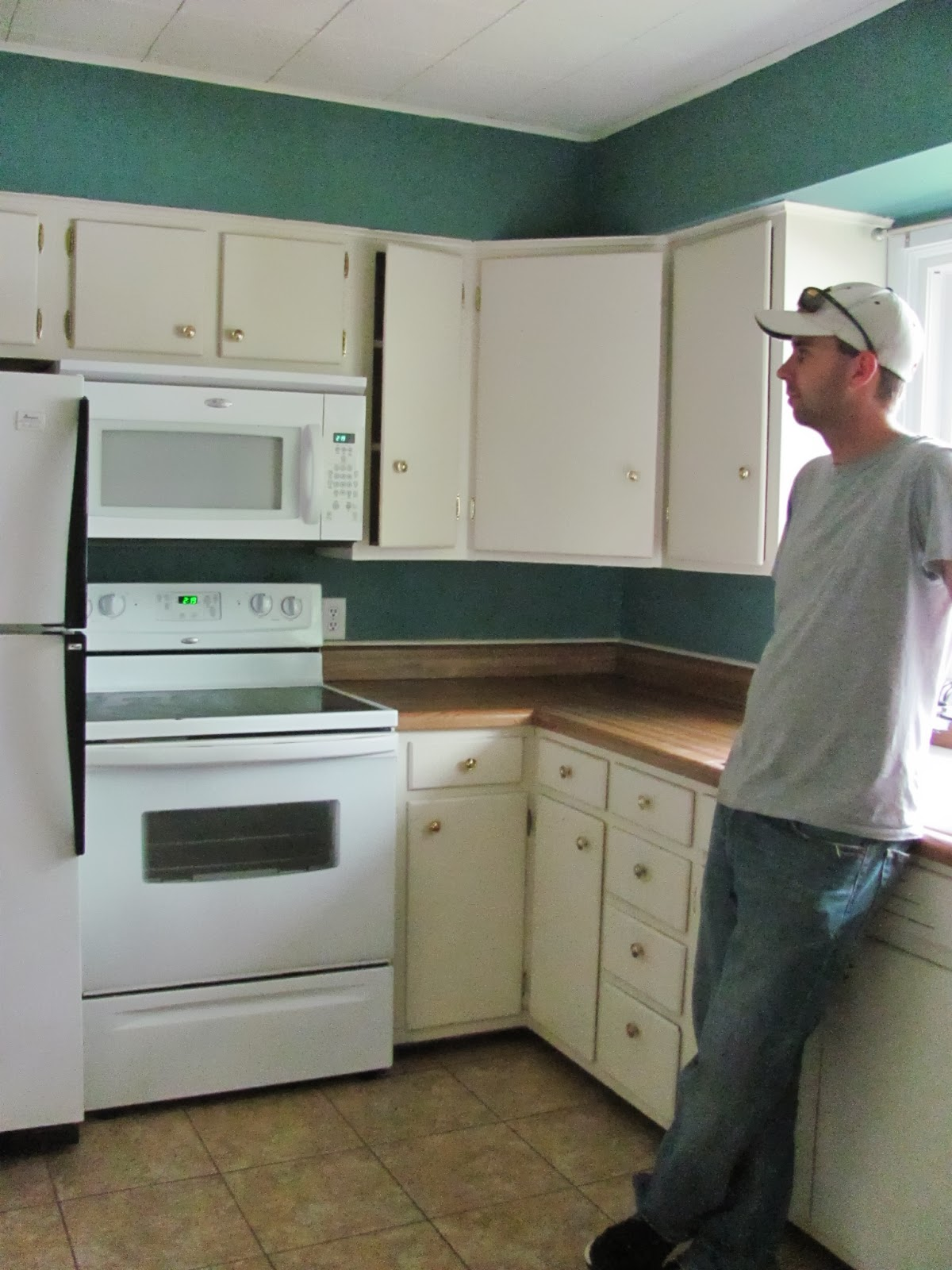 Cory is looking around the kitchen before leaving the old house