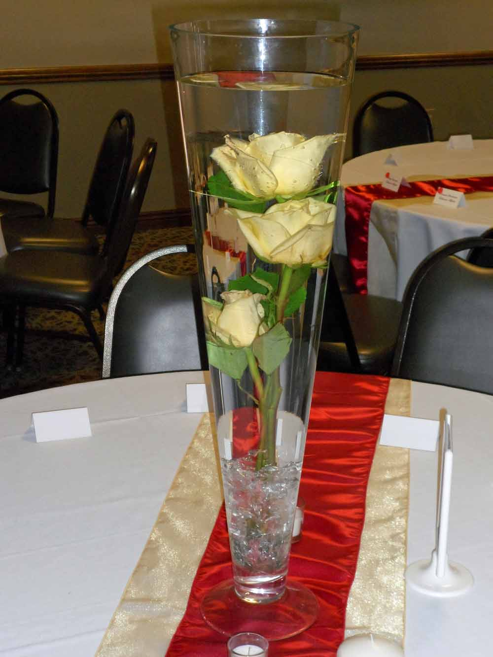 Local wedding red and yellow at windsor stables elite events rental pillar candle centerpiece in a 10x5x5 rectangle vase 4 rental with hydrangea bouquets in 4 cube vases 2 rental on either side reviewsmspy