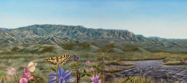 Paisaje con montañas al fondo y flores en primer plano