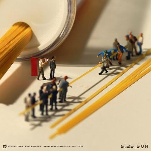 16-Tug-of-War-Tatsuya-Tanaka-Miniature-Calendar-Worlds-www-designstack-co