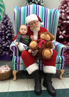 Boy sits on Santa's knee