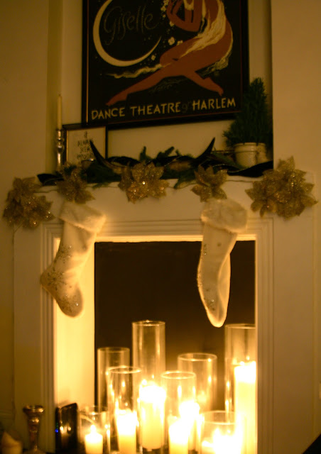 holiday mantle decor and candles in the fireplace