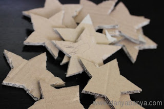 Cut out some stars from corrugated cardboard