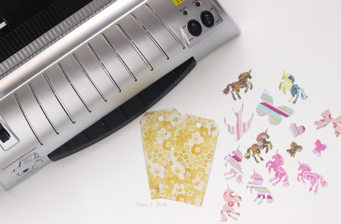 Laminating paper shapes to use for handmade planner clips. www.pitterandglink.com