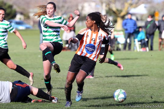 In the goalmouth, three Napier Marist defenders just manage to thwart Kate St Louis, striker with Port Hill - women's soccer at Park Island, Napier, Port Hill won 5-4. photograph