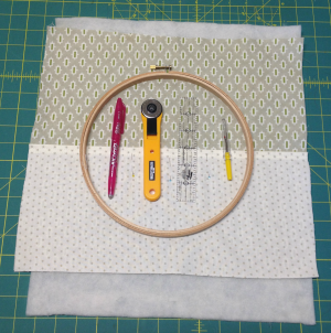 Position the hoop on top of the layers