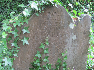 An ivy-covered gravestone at Donnybrook Cemetery Dublin