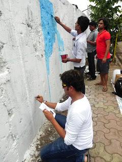 Samrat Bhogle sketching the Superheroes mural for Hemant Sonawane's STUDIO