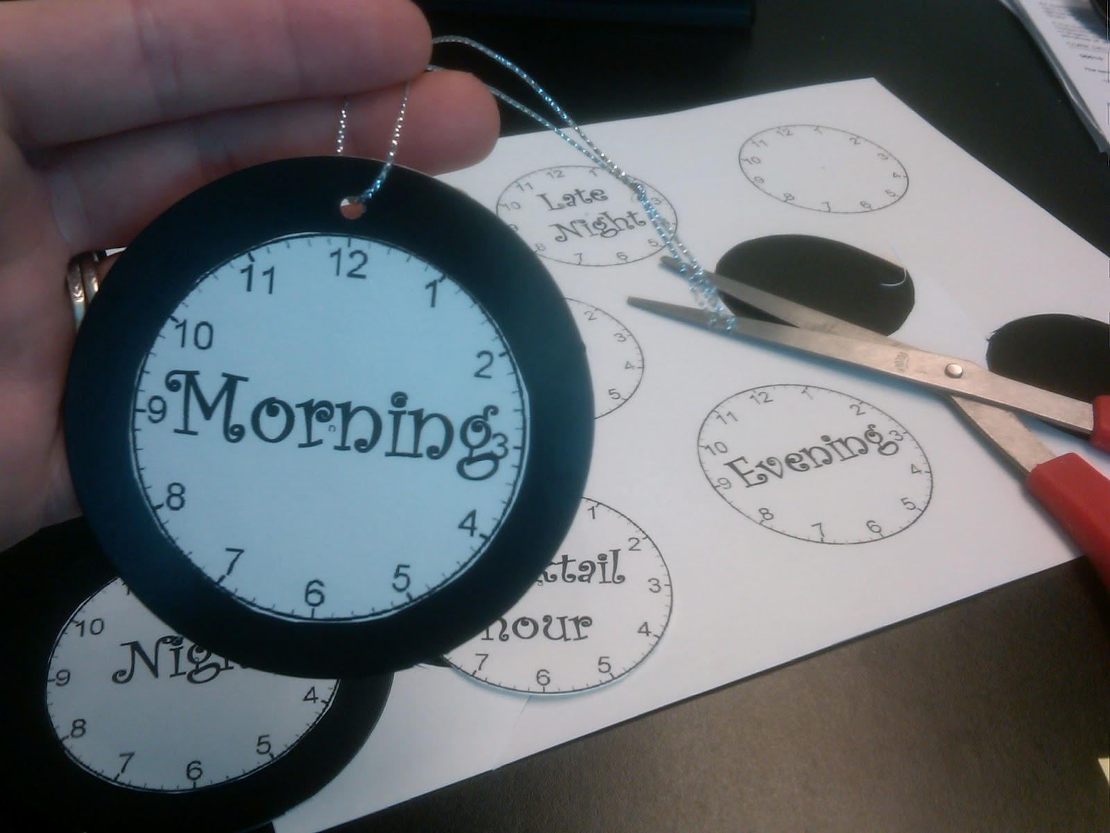 then printed it on heavy white paper cut each clock out and glued onto round gift tags from target
