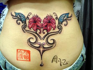 Girly Flower Butterflies and Tribal Tattoo Design on Lower back