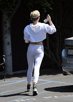Miley Cyrus at a parking lot
