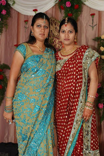 Tamil girls wearing traditional saree on their sisters marriage function.