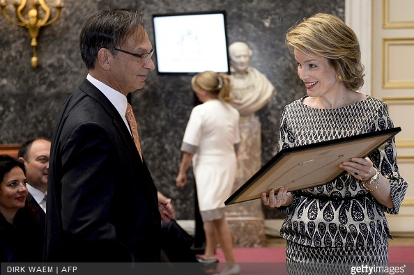 Queen Mathilde of Belgium speaks with Professor Bruce Spiegelman who received the 2015 scientific health prize from the Artois-Baillet Latour Foundation during a ceremony for the Inbev-Baillet Latour awards for Health and Clinical Research in Brussels