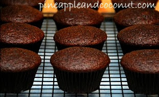 unfrosted chocolate cupcakes on wire cooling rack