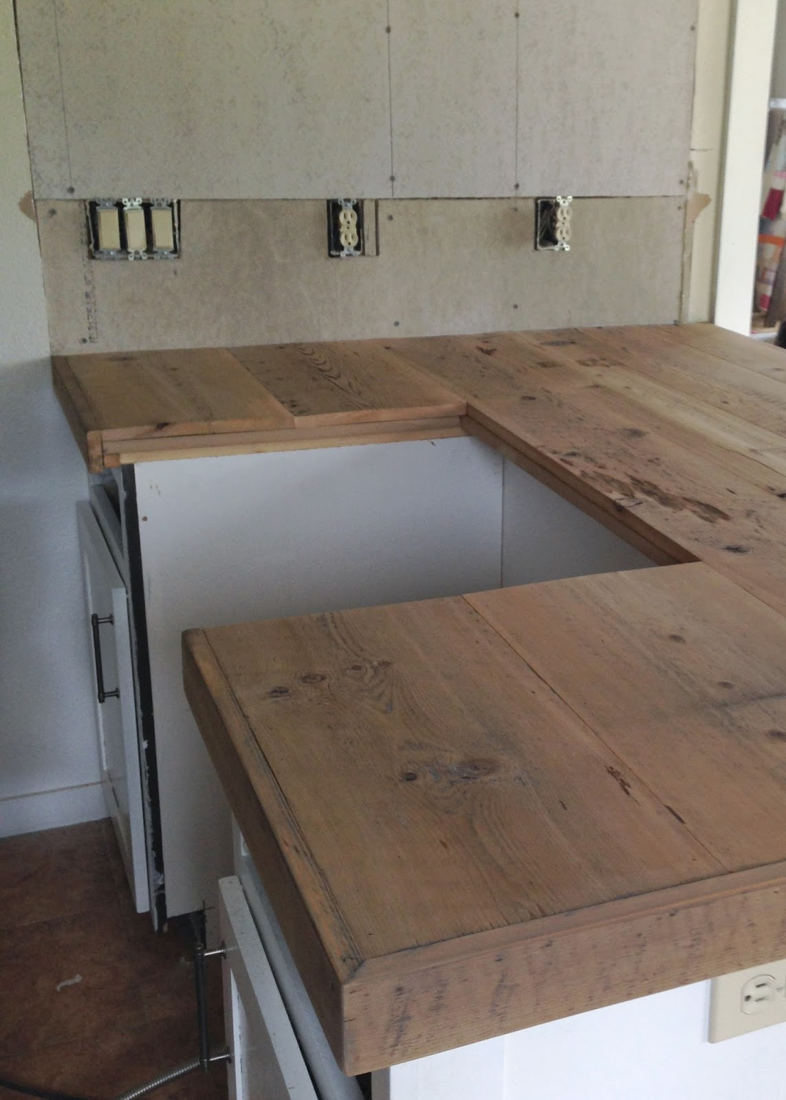 DIY Reclaimed Wood Countertop - adding trim boards along edge - DIY Reclaimed Wood Countertop Averie Lane: DIY Reclaimed Wood