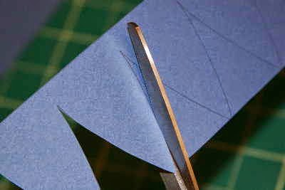 Cutting in curve shapes for making a paper baseball cap