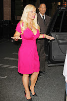 Coco Austin explaining something to the photographers