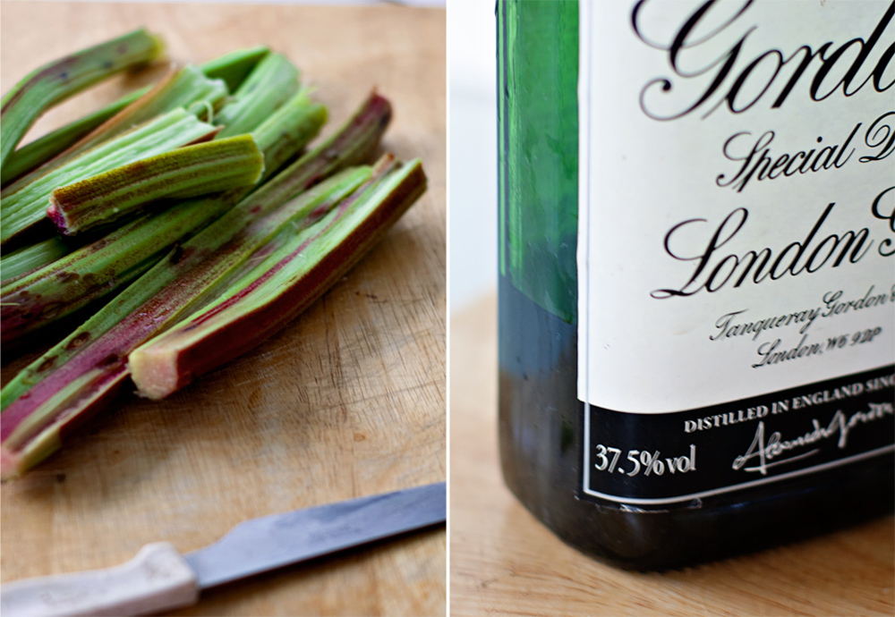 rhubarb stalks on a cutting board and a bottle of sloe gin