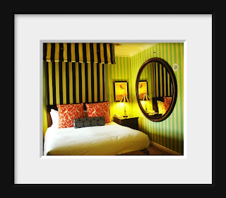 A room at the Monaco Hotel in San Francisco has the rich kitschy colors of Moulin Rouge.