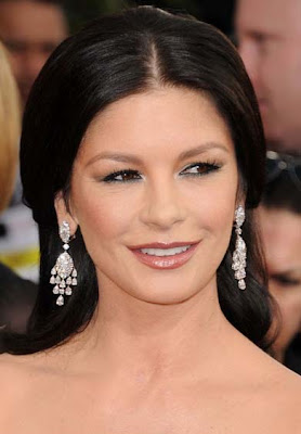 Catherine Zeta Jones punched by a photographer